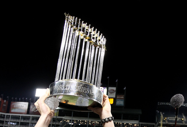 ARLINGTON, TX - NOVEMBER 01:  Tim Lincecum of the San Francisco Giants celebrates with the World Series Championship trophy after the Giants won 3-1 the Texas Rangers in Game Five of the 2010 MLB World Series at Rangers Ballpark in Arlington on November 1