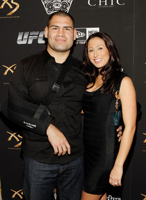 LAS VEGAS - FEBRUARY 15:  UFC fighter Cain Velasquez, left, and his fiance' Michelle Borquez arrive at UFC, Famous Stars and Straps and New Era's 'The Magic Party' at XS the nightclub on February 15, 2011 in Las Vegas, Nevada.  (Photo by Isaac Brekken/Get