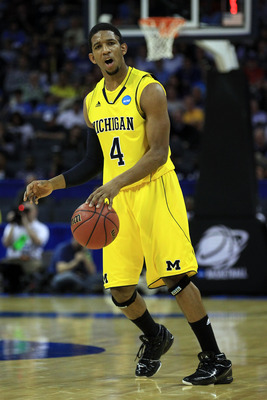 CHARLOTTE, NC - MARCH 20:  Darius Morris #4 of the Michigan Wolverines moves the ball while taking on the Duke Blue Devils during the third round of the 2011 NCAA men's basketball tournament at Time Warner Cable Arena on March 20, 2011 in Charlotte, North