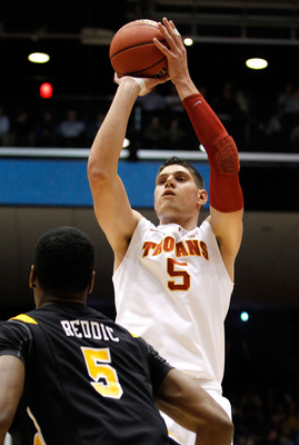 DAYTON, OH - MARCH 16: Nikola Vucevic #5 of the USC Trojans shoots over Juvonte Reddic #5 of the Virginia Commonwealth Rams during the first round of the 2011 NCAA men's basketball tournament at UD Arena on March 16, 2011 in Dayton, Ohio.  (Photo by Grego