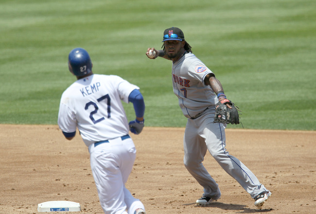 LOS ANGELES, CA - JULY 25:  Shortstop Jose Reyes #7 of the New York Mets throws to first after forcing out Matt Kemp #27 of the Los Angeles Dodgers on July 25, 2010 at Dodger Stadium in Los Angeles, California. The Dodgers won 1-0.  (Photo by Stephen Dunn