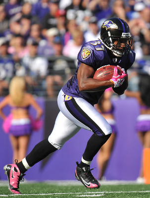 BALTIMORE, MD - OCTOBER 10: Josh Wilson #37 of the Baltimore Ravens returns a kickoff against the Denver Broncos at M&T Bank Stadium on October 10, 2010 in Baltimore, Maryland. Players wore pink in recognition of Breast Cancer Awareness Month. The Ravens