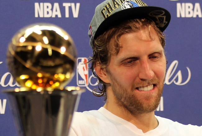 MIAMI, FL - JUNE 12:  Finals MVP Dirk Nowitzki #41 of the Dallas Mavericks answers questions form the media at a post game press conference with the Bill Russell Finals MVP trophy after the Mavericks won 105-95 against the Miami Heat in Game Six of the 20