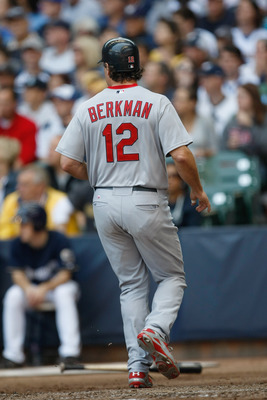 MILWAUKEE, WI - JUNE 12: Lance Berkman #12 of the St. Louis Cardinals steps on home plate as he scores a run against the Milwaukee Brewers at Miller Park on June 12, 2011 in Milwaukee, Wisconsin. (Photo by Scott Boehm/Getty Images)