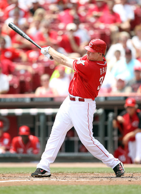CINCINNATI, OH - JUNE 08:  Jay Bruce #32 of the Cincinnati Reds hits a run scoring single during the game against the Chicago Cubs at Great American Ball Park on June 8, 2011 in Cincinnati, Ohio.  (Photo by Andy Lyons/Getty Images)
