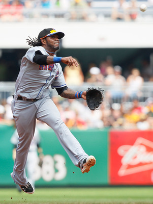 PITTSBURGH - JUNE 12:  Jose Reyes #7 of the New York Mets throws to first base during the game against the Pittsburgh Pirates on June 12, 2011 at PNC Park in Pittsburgh, Pennsylvania.  (Photo by Jared Wickerham/Getty Images)