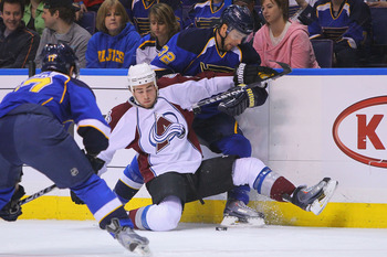 ST. LOUIS, MO - APRIL 5: Chris Porter #32 of the St. Louis Blues trips Ryan O'Reilly #37 of the Colorado Avalanche at the Scottrade Center on April 5, 2011 in St. Louis, Missouri.  (Photo by Dilip Vishwanat/Getty Images)