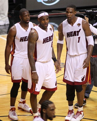 MIAMI, FL - MAY 31:  Dwyane Wade #3, LeBron James #6 and Chris Bosh #1 of the Miami Heat react after the Heat defeat the Dallas Mavericks 92-84 in Game One of the 2011 NBA Finals at American Airlines Arena on May 31, 2011 in Miami, Florida. NOTE TO USER: