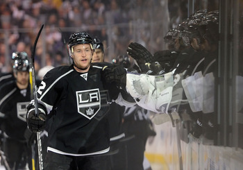 LOS ANGELES, CA - APRIL 19:  Trevor Lewis #22 of the Los Angeles Kings celebrates a goal by Willie Mitchell #33 in the first period against the San Jose Sharks in game three of the Western Conference Quarterfinals during the 2011 NHL Stanley Cup Playoffs
