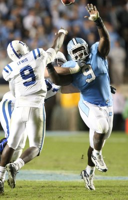 CHAPEL HILL, NC - NOVEMBER 7:  Marvin Austin #9 of the North Carolina Tar Heels pressures Thaddeus Lewis #9 of the Duke Blue Devils at Kenan Stadium on November 7, 2009 in Chapel Hill, North Carolina. (Photo by Streeter Lecka/Getty Images)