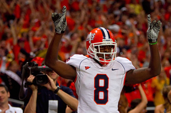ST. LOUIS - SEPTEMBER 4: A.J. Jenkins #8 of the University of Illinois Fighting Illini celebrates his touchdown against the University of Missouri Tigers during the State Farm Arch Rivalry game on September 4, 2010 at the Edward Jones Dome in St. Louis, M