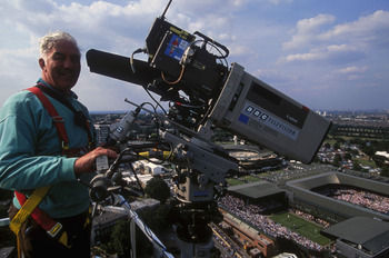 LONDON - JUNE 29:  A BBC cameraman on a skylift crane taken during the Wimbledon Lawn Tennis Championships held on June 29, 1996 at the All England Lawn Tennis and Croquet Club in London. (Photo by Mark Thompson/Getty Images)