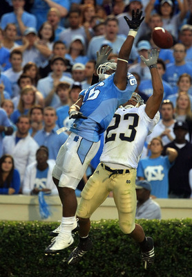 CHAPEL HILL, NC - OCTOBER 11:  Kendric Burney #16 of the North Carolina Tar Heels stops a pass in front of Golden Tate, #23 of the Notre Dame Fighting Irish during their game at Kenan Stadiium on October 11, 2008 in Chapel Hill, North Carolina. (Photo by