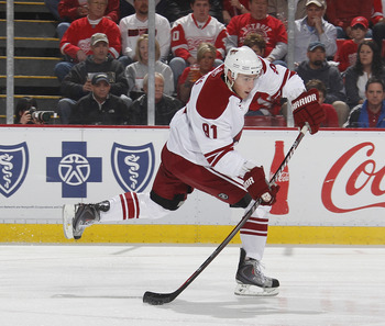 DETROIT, MI - APRIL 16: Kyle Turris #91 of the Phoenix Coyotes skates with the puck while playing the Detroit Red Wings in Game Two of the Western Conference Quarterfinals during the 2011 Stanley Cup Playoffs at Joe Louis Arena on April 16, 2011 in Detroi