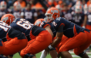 CHAMPAIGN, IL - OCTOBER 02: Nathan Scheelhaase #2 of the Illinois Fighting Illini calls offensive signals as Randall Hunt #66 waits to snap the ball against the Ohio State Buckeyes at Memorial Stadium on October 2, 2010 in Champaign, Illinois. Ohio State