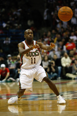 MILWAUKEE, WI - JANUARY 07: Earl Boykins #11 of the Milwaukee Bucks passes against the Miami Heat at the Bradley Center on January 7, 2011 in Milwaukee, Wisconsin. NOTE TO USER: User expressly acknowledges and agrees that, by downloading and or using this