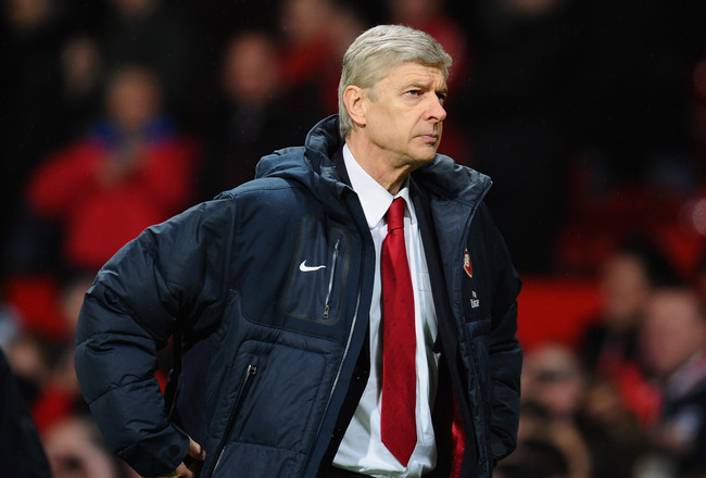 MANCHESTER, ENGLAND - MARCH 12:  Arsenal manager Arsene Wenger looks dejected after defeat in the FA Cup sponsored by E.On Sixth Round match between Manchester United and Arsenal at Old Trafford on March 12, 2011 in Manchester, England.  (Photo by Clive M
