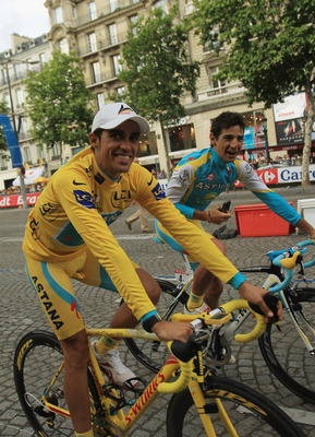 PARIS - JULY 25:  Alberto Contador of team Astana celebrates with teammate David De La Fuente after the twentieth and final stage of Le Tour de France 2010, from Longjumeau to the Champs-Elysees in Paris on July 25, 2010 in Paris, France.  (Photo by Spenc