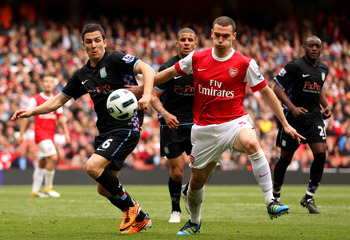 LONDON, ENGLAND - MAY 15:  Thomas Vermaelen (R) of Arsenal collides with Stewart Downing of Aston Villa during the Barclays Premier League match between Arsenal and Aston Villa at the Emirates Stadium on May 15, 2011 in London, England.  (Photo by Richard