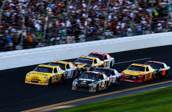 DAYTONA BEACH, FL - FEBRUARY 20:  Clint Bowyer, driver of the #33 Cheerios Chevrolet,  and Ryan Newman, driver of the #39 U.S. Army Chevrolet, lead a group of cars during the NASCAR Sprint Cup Series Daytona 500 at Daytona International Speedway on Februa