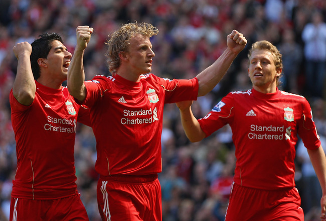 LIVERPOOL, ENGLAND - MAY 01:  Dirk Kuyt of Liverpool celebrates with team mates Luis Suarez and  Lucas after scoring the second goal from the penalty spot during the Barclays Premier League match between Liverpool  and Newcastle United at Anfield on May 1