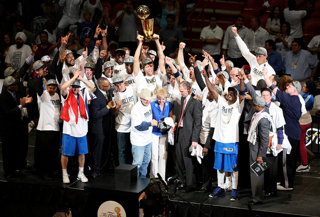 MIAMI, FL - JUNE 12: (L-R) Jaosn Kidd #2, team owner Mark Cuban and finals MVP Dirk Nowitzki #41 of the Dallas Mavericks celebrate after they won 105-95 against the Miami Heat in Game Six of the 2011 NBA Finals at American Airlines Arena on June 12, 2011