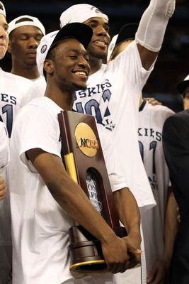 HOUSTON, TX - APRIL 04:  Kemba Walker #15 of the Connecticut Huskies celebrates with the trophy after defeating the Butler Bulldogs to win the National Championship Game of the 2011 NCAA Division I Men's Basketball Tournament by a score of 53-41 at Relian