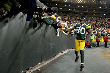 GREEN BAY, WI - JANUARY 02:  Donald Driver #80 of the Green Bay Packers circles the field after the Packers win over the Chicago Bears at Lambeau Field on January 2, 2011 in Green Bay, Wisconsin.  (Photo by Matthew Stockman/Getty Images)
