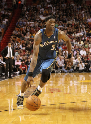 MIAMI, FL - FEBRUARY 25:  Josh Howard #5 of the  Washington Wizards drives against the Miami Heat  at American Airlines Arena on February 25, 2011 in Miami, Florida. NOTE TO USER: User expressly acknowledges and agrees that, by downloading and/or using th
