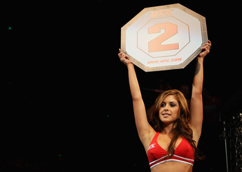 SYDNEY, AUSTRALIA - FEBRUARY 27: Octagon girl Brittney Palmer signals the start of round two at UFC 127 at Acer Arena on February 27, 2011 in Sydney, Australia.  (Photo by Mark Kolbe/Getty Images)