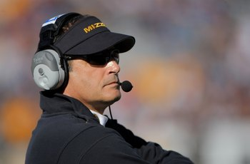 BOULDER, CO - OCTOBER 31:  Head coach Gary Pinkel of the Missouri Tigers leads his team against the Colorado Buffaloes at Folsom Field on October 31, 2009 in Boulder, Colorado. Missouri defeated Colorado 36-17.  (Photo by Doug Pensinger/Getty Images)
