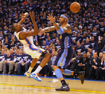OKLAHOMA CITY, OK - APRIL 27: Kenyon Martin #4 of the Denver Nuggets knocks the ball out of the hands of Kevin Durant #35 of the Oklahoma City Thunder in Game Five of the Western Conference Quarterfinals in the 2011 NBA Playoffs on April 27, 2011 at the F