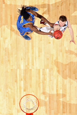 DENVER, CO - MARCH 19:  Dan Geriot #41 of the Richmond Spiders shoots the ball against Kenneth Faried #35 of the Morehead State Eagles during the third round of the 2011 NCAA men's basketball tournament at Pepsi Center on March 19, 2011 in Denver, Colorad