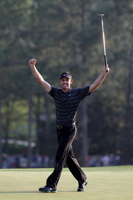 AUGUSTA, GA - APRIL 10:  Charl Schwartzel of South Africa celebrates his birdie on the 18th green and winning the Masters during the final round of the 2011 Masters Tournament at Augusta National Golf Club on April 10, 2011 in Augusta, Georgia.  (Photo by