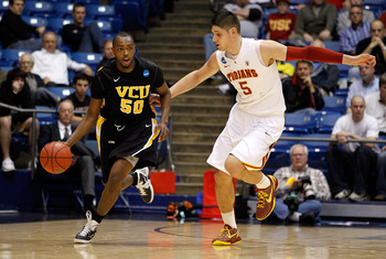 DAYTON, OH - MARCH 16: Ed Nixon #50 of the Virginia Commonwealth Rams dribbles the ball against Nikola Vucevic #5 of the USC Trojans during the first round of the 2011 NCAA men's basketball tournament at UD Arena on March 16, 2011 in Dayton, Ohio.  (Photo