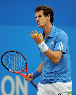 LONDON, ENGLAND - JUNE 11:  Andy Murray of Great Britain reacts to a play during his Men's Singles semi final match against Andy Roddick of the United States on day six of the AEGON Championships at Queens Club on June 11, 2011 in London, England.  (Photo