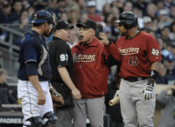 SAN DIEGO, CA - JUNE 4: Manager Brad Mills and Carlos Lee #45 of the Houston Astros argue a call with umpire Todd Tichenor as Rob Johnson #32 of the San Diego Padres looks on during the eighth inning of a baseball game at Petco Park on June 4, 2011 in San