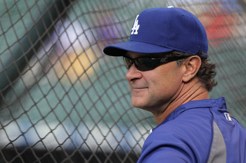 DENVER, CO - JUNE 10:  Manager Don Mattingly of the Los Angeles Dodgers looks on during batting practice prior to facing the Colorado Rockies at Coors Field on June 10, 2011 in Denver, Colorado.  (Photo by Doug Pensinger/Getty Images)