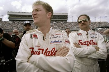 12 Feb 1999: Dale Earnhardt Jr.(L) stands with Dale Earnhardt Sr. during the I.R.O.C Race at the Daytona Speedweek in Daytona, Florida. Mandatory Credit: Jamie Squire  /Allsport