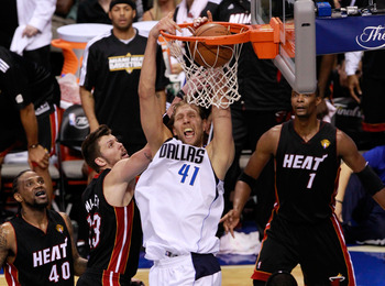 DALLAS, TX - JUNE 09:  Dirk Nowitzki #41 of the Dallas Mavericks dunks against Mike Miller #13 and LeBron James #6 of the Miami Heat late in the fourth quarter in Game Five of the 2011 NBA Finals at American Airlines Center on June 9, 2011 in Dallas, Texa