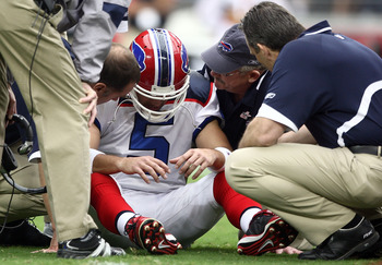 GLENDALE, AZ - OCTOBER 05: Starting Quarterback Trent Edwards #5 of the Buffalo Bills suffers a concussion after getting hit by Strong Safety Adrian Wilson #24 of the Arizona Cardinals during the first half of their NFL Game on October 5, 2008 at Stadium