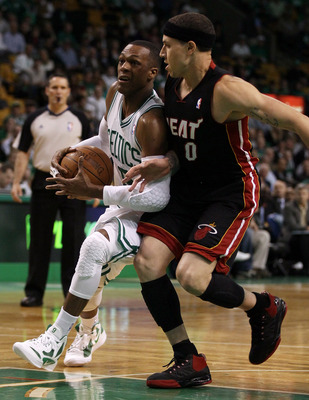 BOSTON, MA - MAY 09:  Rajon Rondo #9 of the Boston Celtics is tripped by Mike Bibby #0 of the Miami Heat in Game Four of the Eastern Conference Semifinals in the 2011 NBA Playoffs on May 9, 2011 at the TD Garden in Boston, Massachusetts.  NOTE TO USER: Us
