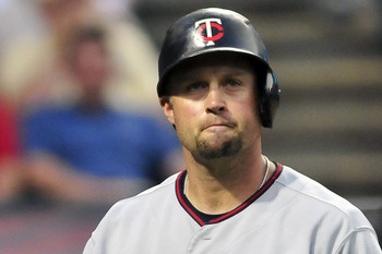 CLEVELAND, OH - JUNE 7: Michael Cuddyer #5 of the Minnesota Twins reacts to striking out in the seventh inning against the Cleveland Indians at Progressive Field on June 7, 2011 in Cleveland, Ohio. The Indians defeated the Twins 1-0. (Photo by Jason Mille