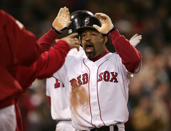 BOSTON - OCTOBER 18:  Dave Roberts #31 of the Boston Red Sox celebrates with his teammates after scoring on a game tying sacrafice fly-out by teammate Jason Varitek #33 in the eighth inning against the New York Yankees during game five of the American Lea