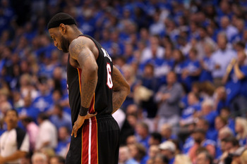 DALLAS, TX - JUNE 09:  LeBron James #6 of the Miami Heat stands on the court with his head down against the Dallas Mavericks in the fourth quarter of Game Five of the 2011 NBA Finals at American Airlines Center on June 9, 2011 in Dallas, Texas.  NOTE TO U