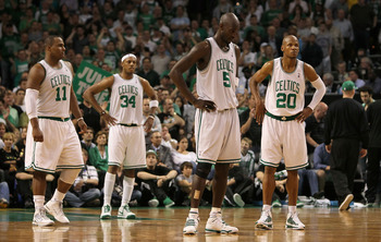 BOSTON - MAY 24:  (L-R) Glen Davis #11, Paul Pierce #34, Kevin Garnett #5 and Ray Allen #20 of the Boston Celtics stand on court late in the game against the Orlando Magic in Game Four of the Eastern Conference Finals during the 2010 NBA Playoffs at TD Ba
