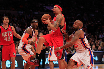 NEW YORK, NY - MARCH 30:  Deron Williams #8 of the New Jersey Nets drives against Anthony Carter#25 of the New York Knicks at Madison Square Garden on March 30, 2011 in New York City. NOTE TO USER: User expressly acknowledges and agrees that, by downloadi
