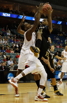 TULSA, OK - MARCH 18:  Keith Benson #34 of the Oakland Golden Grizzlies goes up for a shot against Jordan Hamilton #3 of the Texas Longhorns during the second round of the 2011 NCAA men's basketball tournament at BOK Center on March 18, 2011 in Tulsa, Okl