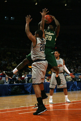 NEW YORK - MARCH 10:  Dominique Jones #20 of the USF Bulls goes to the hoop against Jerrelle Benimon #20 of the Georgetown Hoyas during the second round of 2010 NCAA Big East Tournament at Madison Square Garden on March 10, 2010 in New York City.  (Photo