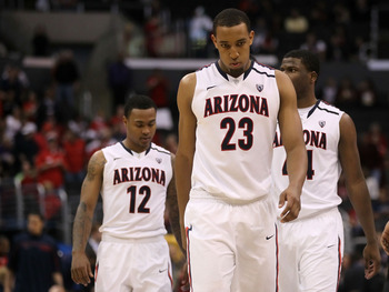 LOS ANGELES, CA - MARCH 12:  Derrick Williams #23 of the Arizona Wildcats walks ahead of teammates Lamont Jones #12 and Solomon Hill #44 while taking on the Washington Huskies in the championship game of the 2011 Pacific Life Pac-10 Men's Basketball Tourn